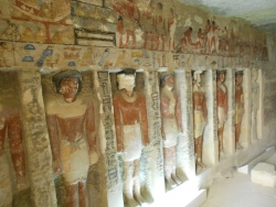 Fig. 27. Wall of funerary chapel, with engaged statues, tomb of Iru-ka-ptah, Saqqara