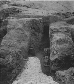 Fig. 85. The Harvard University-Museum of Fine Arts Expedition's discovery of four triads of Menkaure, from the king's valley temple, looking north, July 10, 1908. One of the triads is in the exhibition (cat. no. 68).