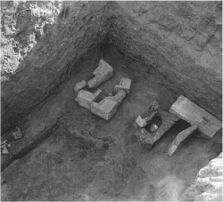 Fig. 86. Statuettes of Menkaure in various stages of completion, as found in the king's valley temple, July 14, 1908