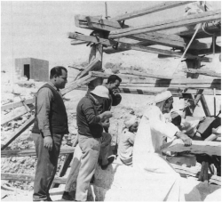 Fig. 100. Ahmed Moussa (left) and Mamdouh Yacoub (second from left) during the uncovering of the tomb of Nefer and Ka-hay, Giza, 1969