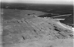 Fig. 84. East half of the great Western Cemetery, December 1906, looking north from the pyramid of Khafre. At this early stage only portions of cemeteries 2000 and 2x00 (far left, center) have been excavated by Reisner. The famous Mena House Hotel appears near the center of the image