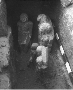 Fig. 92. The Harvard University-Museum of Fine Arts Expedition's discovery of Fifth Dynasty statues of Raramu and his family in the serdab of mastaba tomb 2099, looking east, January 31, 1939. From Roth 1995