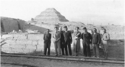 Fig. 93. Zakaria Ghoneim. (left), Selim Hassan (fourth from left), and Zaki Saad (third from right), Saqqara, January 16, 1927