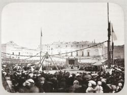 Vista de la colocación de la primera piedra para el edificio de la Biblioteca y Museo Nacional en el instante en que SS.MM. y SS. Ministros firman el Acta, 1866