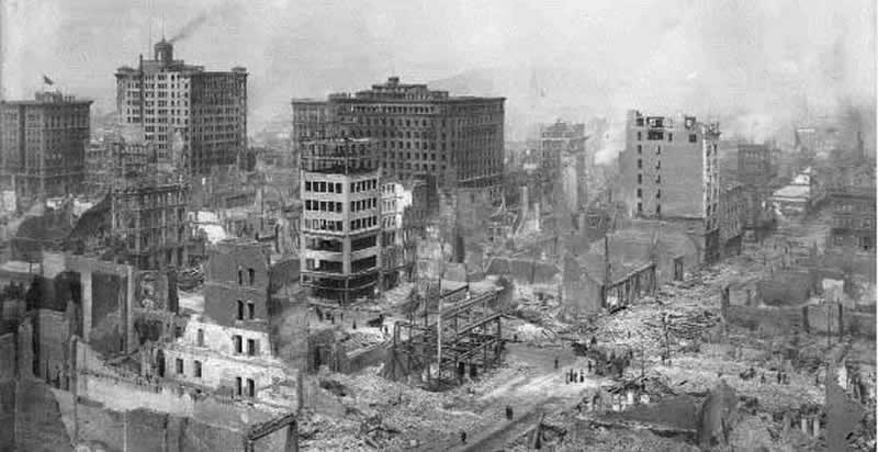 Panorama of the Destroyed City. Three surviving structures in the Financial District can be seen in this dramatic photo. At far left is the Kohl Building on Montgomery Street, the Merchants' Exchange Building on California and, in the center of the picture, the Mills Building on Montgomery.