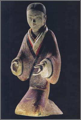 Dinastía Han. Estatuilla de terracota de una joven sirvienta