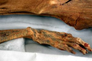 Tattooed hand of a mummy from the ancient Moche culture in Trujillo