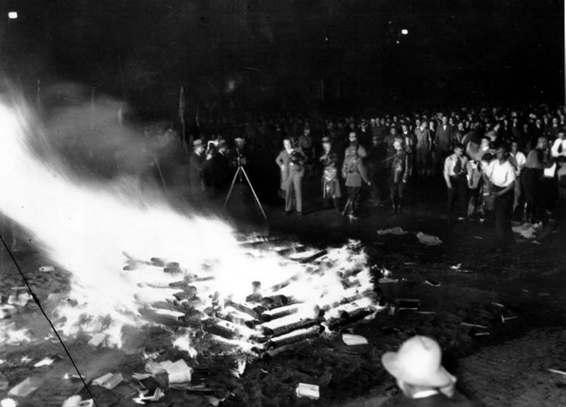 "Nazis burn books deemed ""un-German"" in Berlin's Franz Josef Platz, May 1933. AP PHOTO"