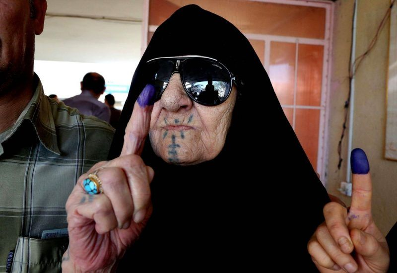 An Iraqi woman shows her ink-stained finger after voting at a polling station in Baghdad on Wednesday. (Karim Kadim / Associated Press / April 30, 2014)