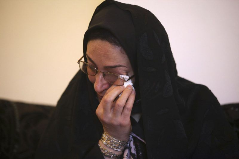 Samereh Alinejad wipes away tears at her home while talking about her son who was killed in a street brawl in Iran. Alinejad told The Associated Press that she had felt she could never live with herself if the man who killed her son were spared from execution. But in the last moment, she pardoned him in an act that has made her a hero in her hometown, where banners in the streets praise her family's mercy. (Vahid Salemi / Associated Press)