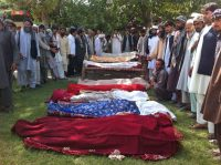 In September 2012, Afghans gathered around the bodies of people reported to have been killed during clashes with an anti-Taliban militia that attacked civilians in Kunduz Province. Credit European Pressphoto Agency