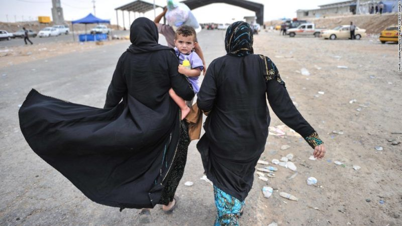 MOSUL, IRAQ - JUNE 12: Civilians escape from Mosul and come to a region that close to Erbil city and are placed to camp by United Nations and Kurd government in Iraq on 12 June, 2014. (Photo by Onur Coban/Anadolu Agency/Getty Images)