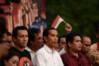 """After a tense two-week ballot recount in Indonesia's closest ever race for the top job, election officials declared the popular governor of Jakarta, Joko """"Jokowi"""" Widodo, center, the winner in the July 9 presidential election. (Romeo Gacad / AFP/Getty Images)"""