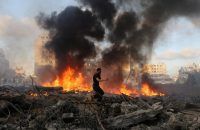 A Palestinian runs in an area damaged in an Israeli airstrike in Gaza City. (Hatem Moussa/AP)