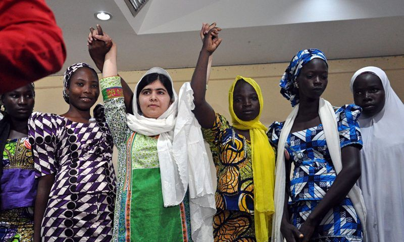 Pakistani education activist Malala Yousafzai poses with five escaped Chibok school girls – the Nigerian government has not done enough to help the others Photograph: Isaac Babatunde/AFP/Getty Images