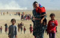 Displaced people from the minority Yazidi sect, fleeing violence from forces loyal to the Islamic State in Iraq and Syria.Credit...Rodi Said/Reuters