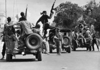 Khmer Rouge guerrillas moving into Phnom Penh on April 17, 1975, before forcibly emptying the city of its two million residents. Credit Sjoberg/Scanpix Sweden, via Agence France Presse