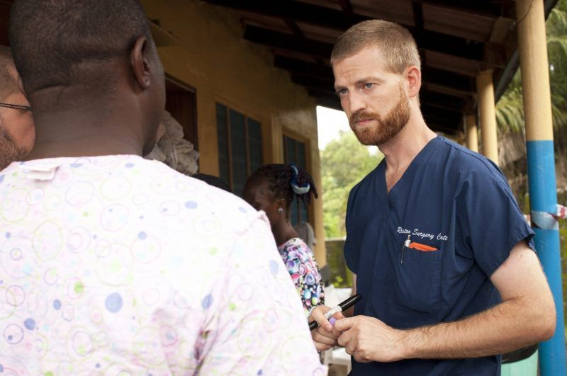In this handout provided by Samaritan's Purse, Dr. Kent Brantly (R), one of the two Americans who contracted Ebola, works at an Ebola isolation ward at a mission hospital outside of Monrovia, Liberia. Brantly arrived on U.S. soil after contracting the deadly disease and is showing signs of improvement as he is treated at Emory University Hospital in Atlanta, Georgia. (Photo by Samaritans Purse via Getty Images) (Handout/Getty Images)