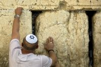 A Jewish man places a note at the Western Wall, the holiest site where Jews can pray, ahead of the Jewish New Year in Jerusalem's old city. (Sebastian Scheiner/AP)