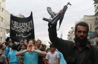Supporters of the Al Nusra Front take part in a protest against Syrian President Bashar al-Assad. (Fadi Al-Halabi/AFP/Getty Images)