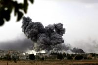 Smoke rises from the Syrian town of Kobani, seen from the Turkish-Syrian border in Suruc, Turkey. Kurdish forces urged a U.S.-led coalition to escalate air strikes on Islamic State fighters who tightened their grip on the Syrian town. (Getty Images)