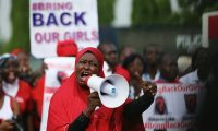 Protesters call on the Nigerian government to rescue the girls taken by Boko Haram from a school in Chibok. Photograph: Afolabi Sotunde/Reuters