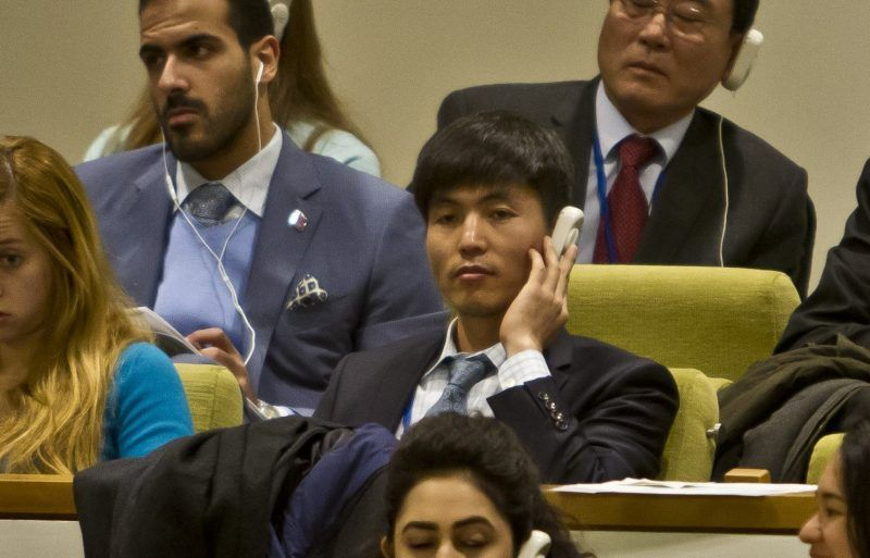 North Korean dissident Shin Dong-Hyuk, center, holds his ear-piece as he listens during a meeting of the U.N. General Assembly human rights committee on a proposal to refer North Korea to the International Criminal Court for alleged crimes against humanity, Tuesday, Nov. 18, 2014. A North Korean diplomat, foreign ministry adviser Kim Ju Song was witnessed trying to get a U.N. official to eject Shin Dong-Hyuk, who fled North Korea and has since spoken out against the government. (Bebeto Matthews/AP)
