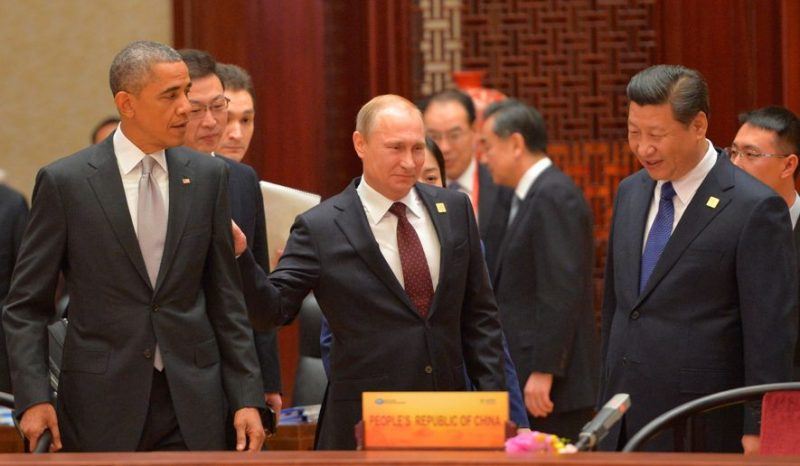 upper hand: Russian President Vladimir Putin (center) signed a natural gas agreement with Chinese President Xi Jinping, but President Obama is still working on a deal. (RIA Novosti via Associated Press)