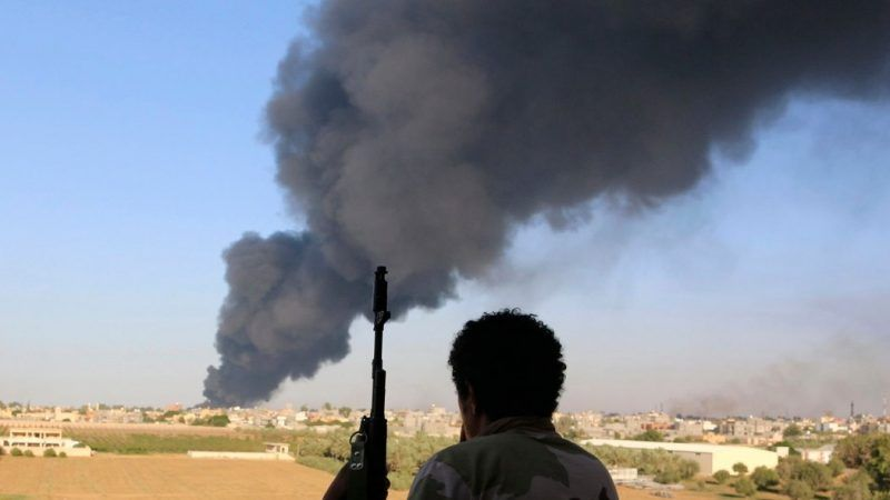 A fuel tank in Tripoli burning after being hit by militia rocket fire last August. Credit Hani Amara/Reuters