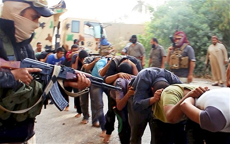 Isis militants apparently leading away captured Iraqi soldiers in Tikrit