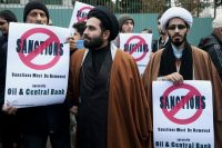 In this Sunday, Nov. 23, 2014 photo, two clergymen attend a gathering in front of the headquarters of Iran's Atomic Energy Organization, to show their support for Iran's nuclear program in Tehran, Iran. (Ebrahim Noroozi/AP)