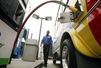 Yonathan Araya fills up a Payless car rental shuttle van at a Clean Energy Fuels station in Santa Ana. (Los Angeles Times)