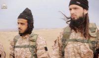 An image grab taken from an Islamic State propaganda video released on Nov. 16 shows a fighter, on the right, believed to be French citizen Maxime Hauchard. (AFP/Getty Images)