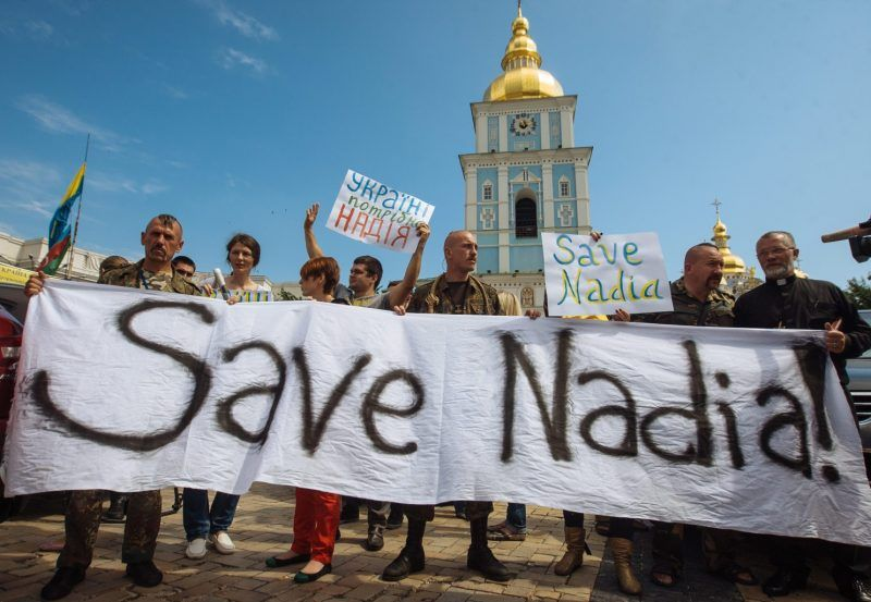 Ukrainian activists hold a banner reading 'Save Nadia' during a rally demanding the release of Ukrainian officer Nadiya Savchenko from Russian prison in Kiev, Ukraine, 11 July 2014. (Roman Pilipey/EPA)