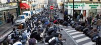 Muslims pray in the street during Friday prayers in Paris. Photograph: Charles Platiau/Reuters/Corbis