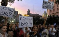 """BUENOS AIRES: People hold signs reading """"Enough, Cristina"""" and """"Thank you, Nisman"""" in a protest against the death of public prosecutor Alberto Nisman. He was found dead just days after accusing President Cristina Kirchner of obstructing a probe into a 1994 Jewish center bombing. ALEJANDRO PAGNI AFP/Getty Images"""