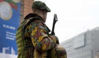 A Belgian soldier patrols in front of EU headquarters in Brussels on Monday, Jan. 19, 2015. Security has been stepped up after thirteen people were detained in Belgium in an anti-terror sweep following a firefight in Verviers, in which two suspected terrorists were killed. (AP Photo/Virginia Mayo)