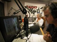 Anchors reading the news at Radio Marti, the Miami-based, U.S. government funded station that broadcasts news and information to Cuba. (Gary Marx/Chicago Tribune)