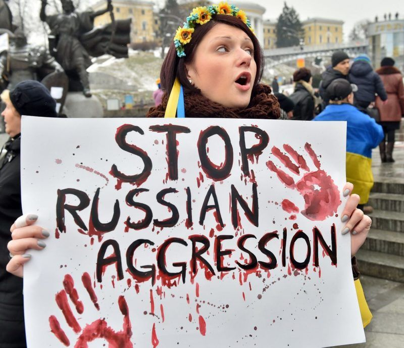 Demonstrators rally in Kiev after last weekend's shelling that left at least 30 people dead and more than 100 injured in the Ukrainian-controlled port of Mariupol. (Sergei Supinsky/ AFP/Getty Images)