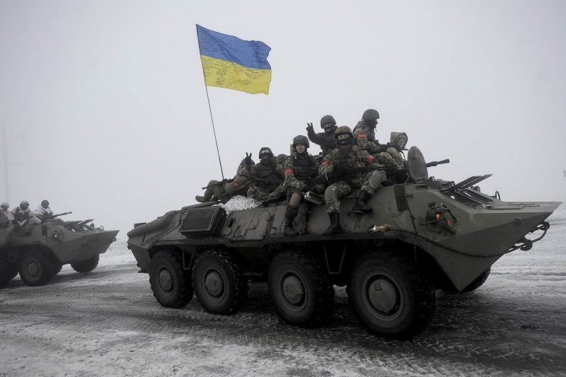 Ukrainian servicemen sit atop an armored personnel carrier (APC) as they patrol Orekhovo village in Luhansk region January 28, 2015. (Maksim Levin/Reuters)