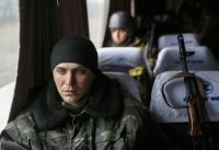 Ukrainian servicemen who fought in Debaltseve are seen in a bus before leaving for home, near Artemivsk, Feb. 19, 2015. REUTERS/Gleb Garanich