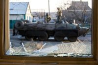 Ukrainian servicemen are seen standing on an Armoured Personnel Vehicle (APC) through a broken window in the village of Horlivka, Donetsk region, on February 4, 2015. (Volodymyr Shuvayev/AFP/Getty Images)