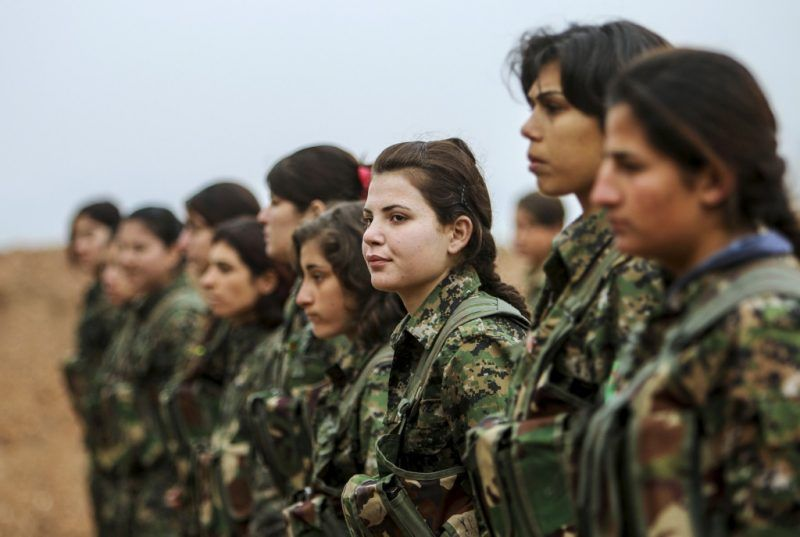 Female fighters of the Kurdish People's Protection Units (YPG) stand at attention at a military camp in Ras a-Ain January 30, 2015. Picture taken January 30, 2015. REUTERS/Rodi Said