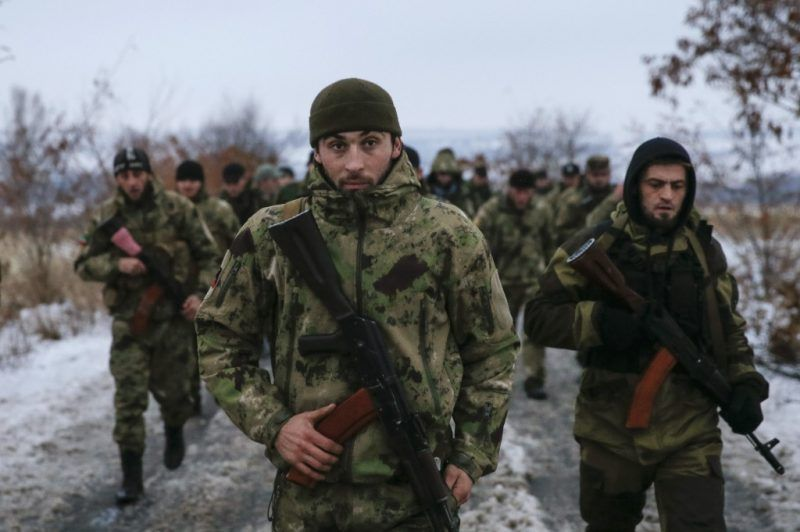 """Pro-Russian separatists from the Chechen """"Death"""" battalion walk during a training exercise in the territory controlled by the self-proclaimed Donetsk People's Republic, eastern Ukraine, December 8, 2014. REUTERS/Maxim Shemetov"""