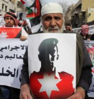 A demonstrator in Amman, Jordan, holds an image of pilot Moaz Kasasbeh, who was burned to death by Islamic State. (Jordan Pix / Getty Images)