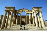 Iraqi children run in front of a temple in the historic city of Hatra, north of Baghdad, Dec. 6, 2002. Reports say Islamic State destroyed at least parts of the city, REUTERS