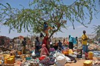 Somali refugees stand amongst their scattered belongings after their temporary shelters were destroyed by Somali soldiers on March 4, 2015 at the Sarkusta refugee camp in southern Mogadishu. Dozens of houses and shops were destroyed in the area after the Somali government ordered the demolition of makeshift homes. (Mohamed Abdiwahab/AFP/Getty Images)