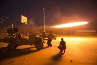 Shi'ite fighters fire a rocket during clashes with Islamic State militants in Salahuddin province March 1, 2015. REUTERS/Ahmed Al-Hussaini