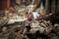 A religious statue in the rubble of a damaged temple at the Bhaktapur district in Nepal on April 27. (Abir Abdullah / EPA)