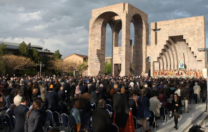 People attend a canonization ceremony for the victims of the Armenian Genocide at the Mother See of Holy Etchmiadzin complex outside Yerevan, Armenia, on April 23. (Vahram Baghdasaryan / EPA)